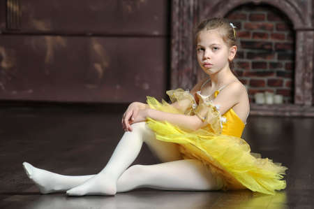 Young ballerina against black background. photo