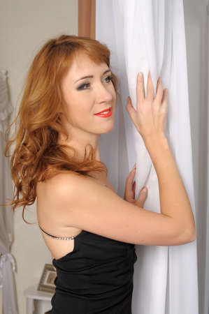 woman in a black evening dress photo