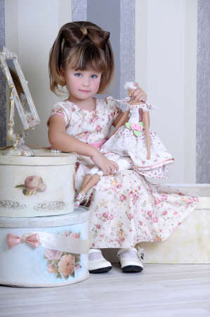 girl playing with a doll Stock Photo - 17965192
