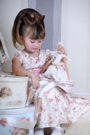 girl playing with a doll Stock Photo - 17965201