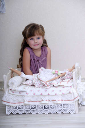 girl playing with a doll photo