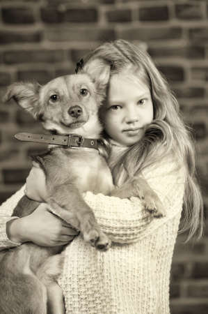 girl with red puppy hugs Stock Photo - 17787484