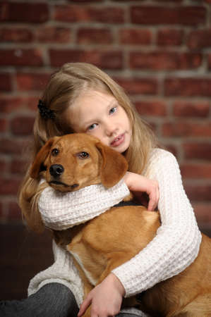 girl with red puppy hugs Stock Photo - 17787493