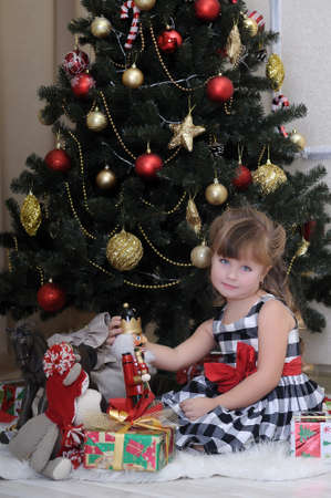 girl with a gift near the Christmas tree Stock Photo - 17934268
