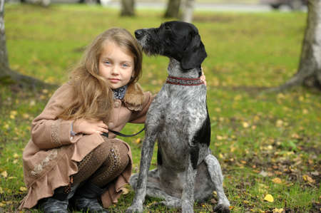 girl with a dog in the park photo