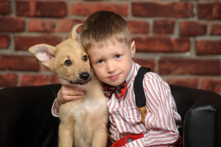 untroubled: boy with a puppy Stock Photo