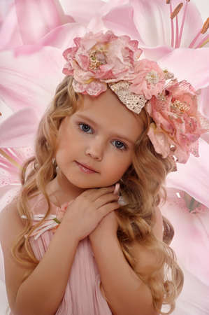 Portrait of a charming little girl with a wreath of roses Stock Photo - 18339420