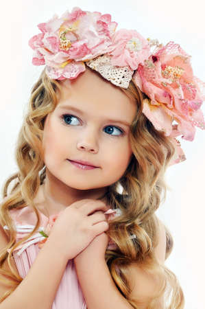 endearing: Portrait of a charming little girl with a wreath of roses