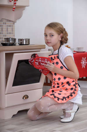 girl at the stove in the kitchen photo