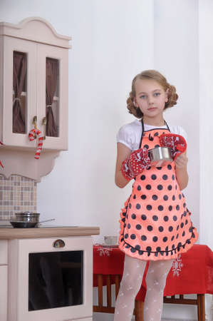 sexy housewife: girl in the kitchen with a pan Stock Photo