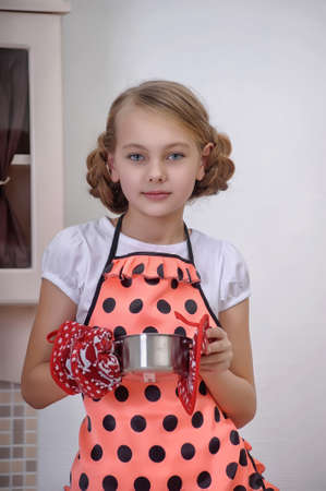 girl in the kitchen with a pan Stock Photo - 17932215