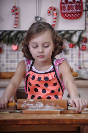 Girl in the kitchen stained with flour photo