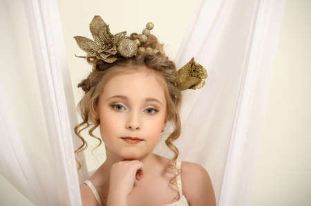 Portrait of a girl with a golden wreath on head photo