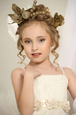 patrician: Portrait of a girl with a golden wreath on head Stock Photo
