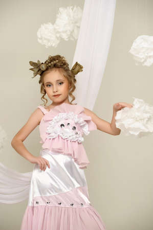 flirting little girl pink dress Stock Photo - 18592452