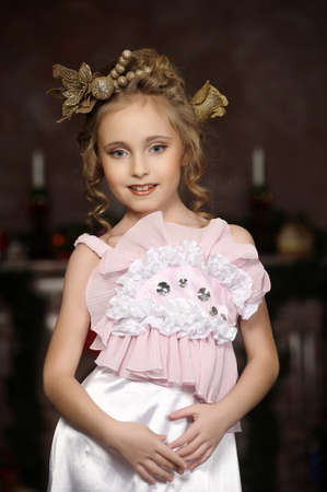 curtsy: flirting little girl pink dress Stock Photo