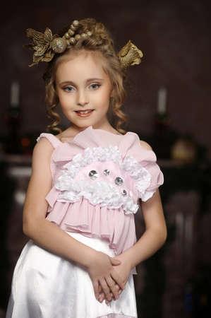 flirting little girl pink dress Stock Photo - 18592449