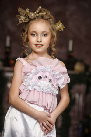 eyeing: flirting little girl pink dress Stock Photo