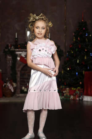 full lips: flirting little girl pink dress Stock Photo