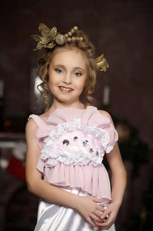 flirting little girl pink dress Stock Photo - 18592446