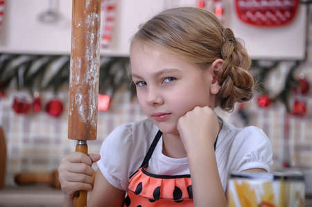 baker's: Girl in the kitchen stained with flour Stock Photo