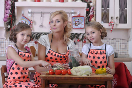 mother with two daughters in the kitchen Stock Photo - 18207260