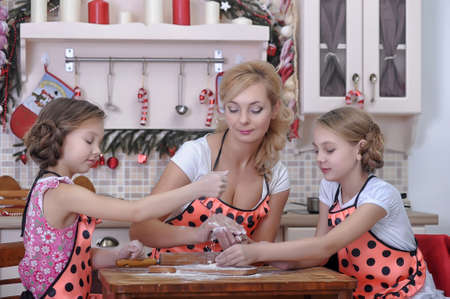 mother with two daughters in the kitchen Stock Photo - 18207269