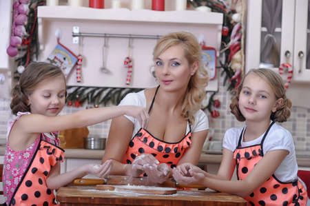 mother with two daughters in the kitchen Stock Photo - 18207261