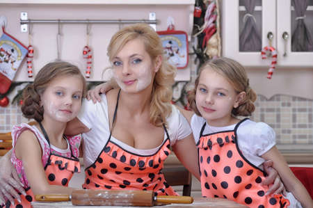 mother with two daughters in the kitchen Stock Photo - 18207263