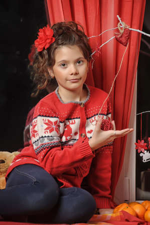 Portrait of a young girl in a red sweater photo