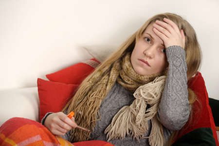 prevention of disease: girl a cold, headache and temperature Stock Photo