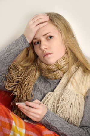 girl a cold, headache and temperature Stock Photo - 19349205