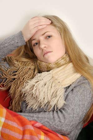 girl a cold, headache and temperature Stock Photo - 19349200