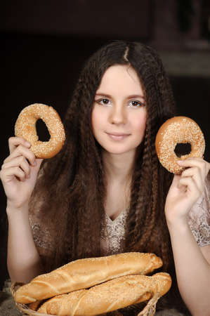 Beautiful girl with bread products in hands photo