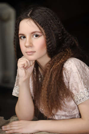 portrait of a beautiful teenager girl with long hair photo