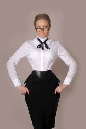 business woman in a white blouse and black skirt