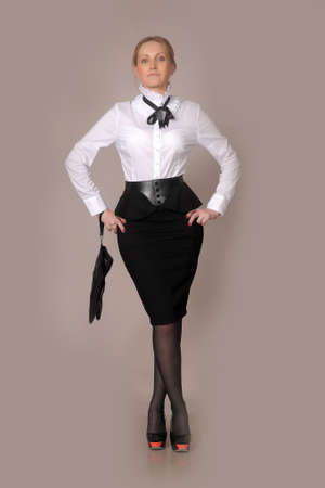 business woman in a white blouse and black skirt photo