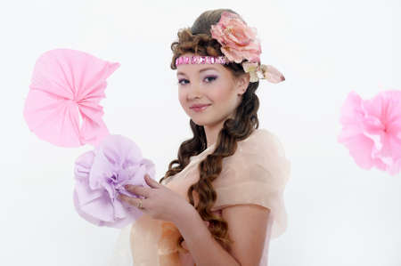 beautiful girl in pink with a flower in her hair Stock Photo - 17976052