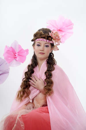 beautiful girl in pink with a flower in her hair Stock Photo - 17976062