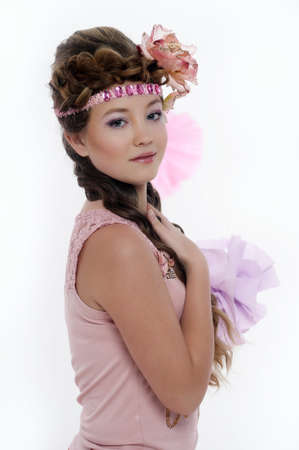 beautiful girl in pink with a flower in her hair Stock Photo - 17976067