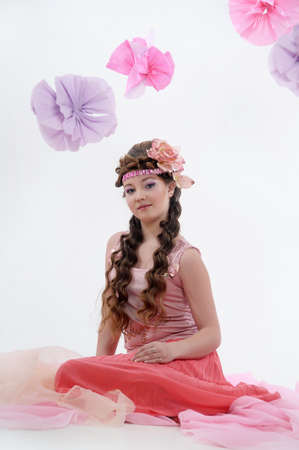 beautiful girl in pink with a flower in her hair photo