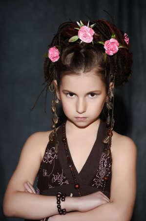 portrait of girl in ethnic style with roses in her hair photo