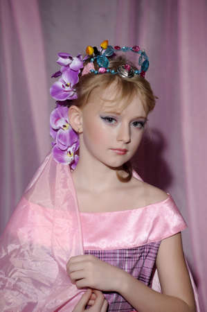 portrait of girl with orchids in her hair and a crown Stock Photo - 18850514