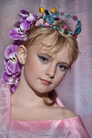 portrait of girl with orchids in her hair and a crown photo