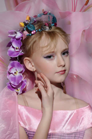 portrait of girl with orchids in her hair and a crown Stock Photo - 18850513