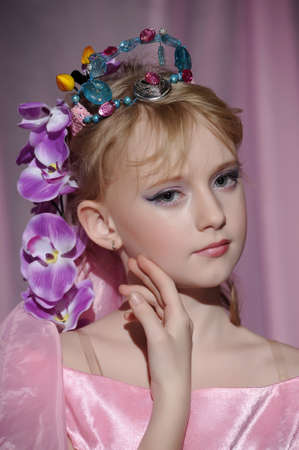 portrait of girl with orchids in her hair and a crown Stock Photo - 18850511