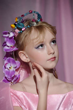 portrait of girl with orchids in her hair and a crown Stock Photo - 18850516