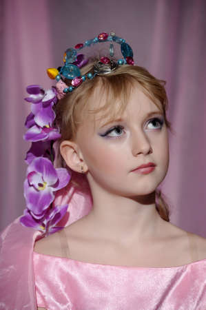 portrait of girl with orchids in her hair and a crown Stock Photo - 18850510