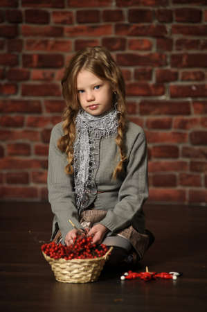 portrait of a girl with a mountain ash in the hands  photo