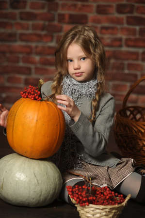 Autumn portrait of a girl with a pumpkin Stock Photo - 18207244